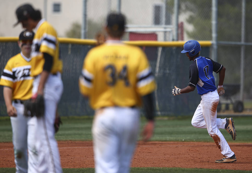Basic's Garrett Giles (17) rounds the bases on a home run against Galena during a Clas ...