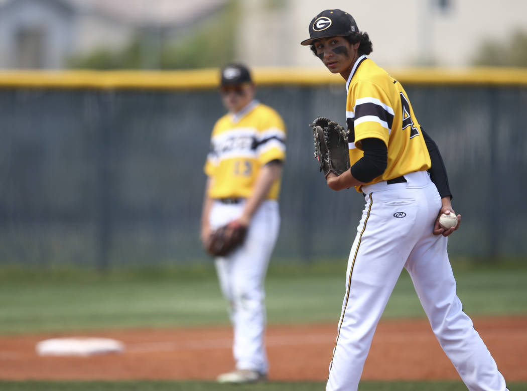Galena's Brandon Scheid (4) glances at first base before pitching to Basic during a Cl ...