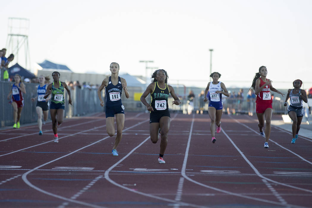 Rancho junior Gizelle Reid (742) places first in the girls 4A 400-meter dash at the NIAA Sta ...