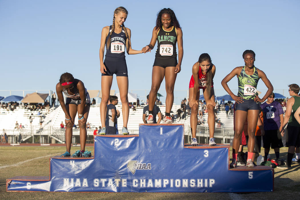 Centennial senior Karina Haymore (191), who placed second, holds hands with Rancho junior Gi ...