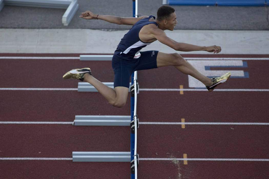Legacy senior Jamaal Britt takes the lead during the boys 300-meter hurdles at the NIAA Stat ...
