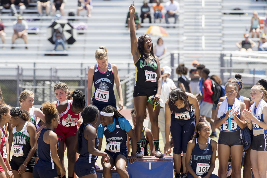 Girls 4×100-meter relay runners fill the podium for their medals during the NIAA 4A Sta ...