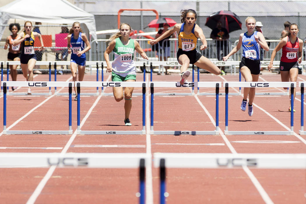 South Tahoe senior Maya Brosch clears a hurdle during the girls 300-meter hurdles during the ...