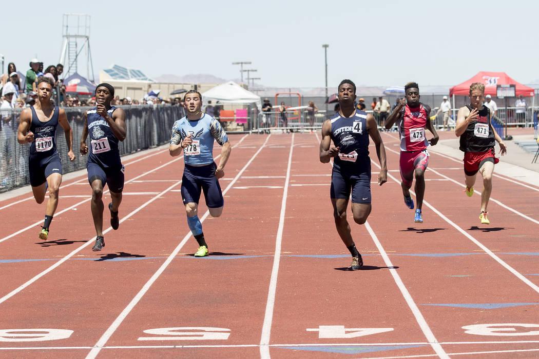 Centennial senior Savon Scarver takes the lead in the boys 200-meter dash during the NIAA St ...
