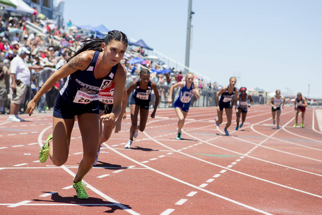 Runners take off in the girls 800-meeter run during the NIAA State Track & Field Champio ...