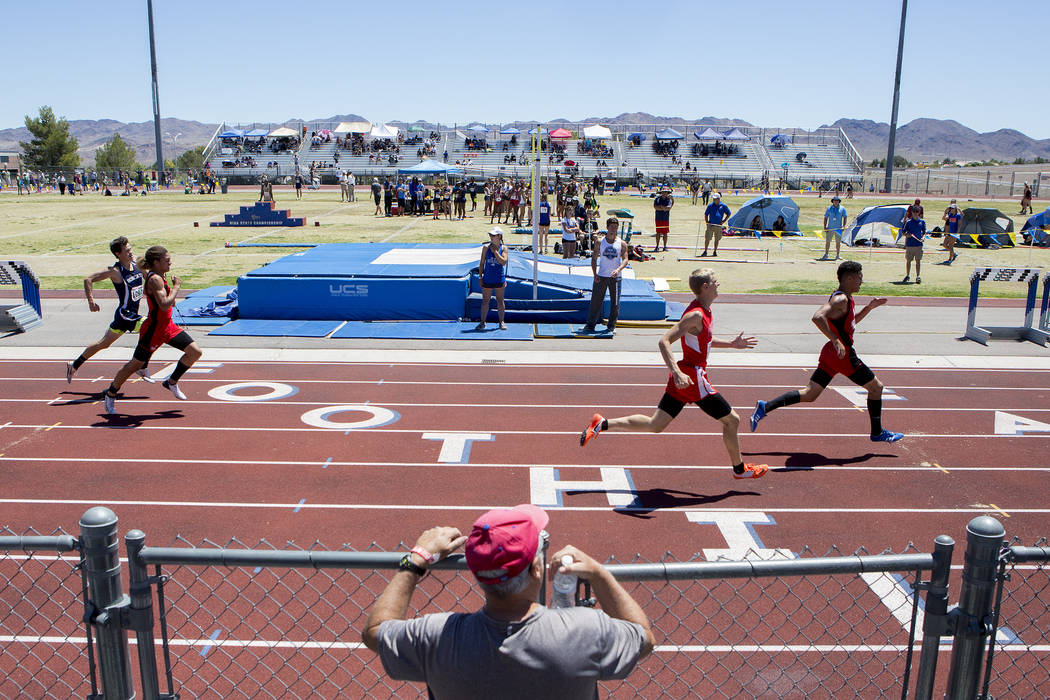 A spectator watches events at the NIAA State Track & Field Championships at Foothill Hig ...