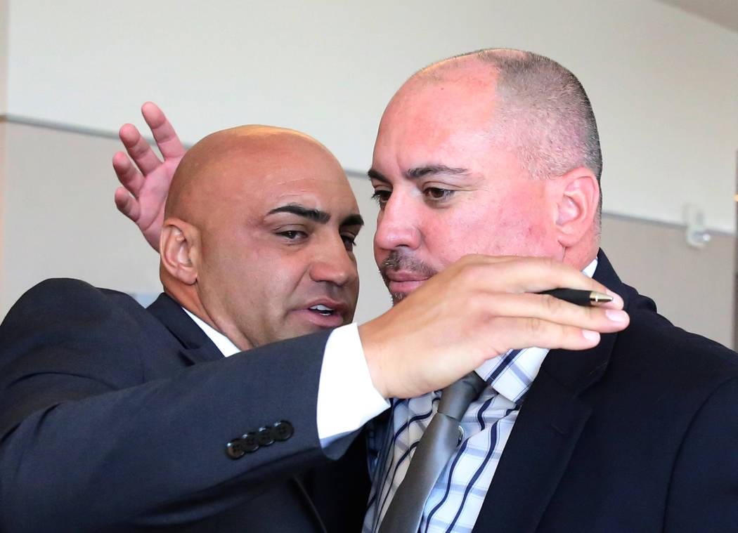 Kenny Sanchez, Bishop Gorman's head football coach, left, hugs his brother Tony Sanch ...