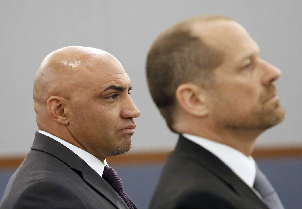 Kenny Sanchez, left, Bishop Gorman's head football coach charged with domestic violenc ...