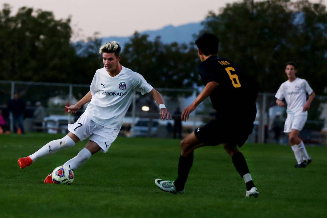 Coronado's John Lynam (7) kicks the ball against Durango at the Bettye Wilson Soccer c ...