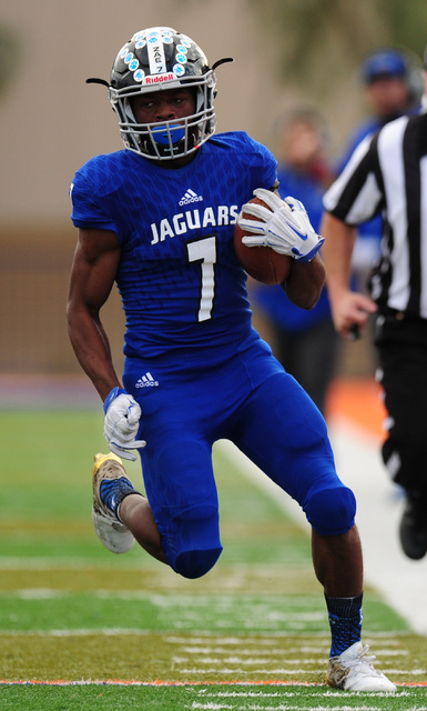 Desert Pines running back Isaiah Morris rushes for a first down against Spring Creek in the ...