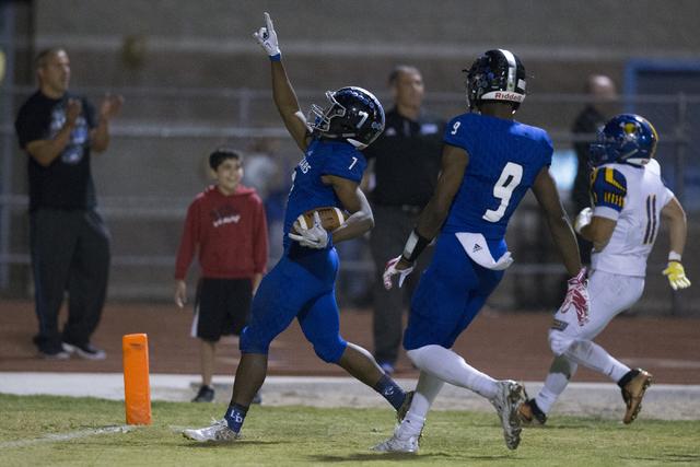 Desert Pines running back Isaiah Morris (7) gestures as he scores a touchdown against Moapa ...