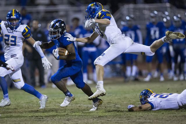 Desert Pines running back Isaiah Morris (7) runs the ball against Moapa Valley in their stat ...
