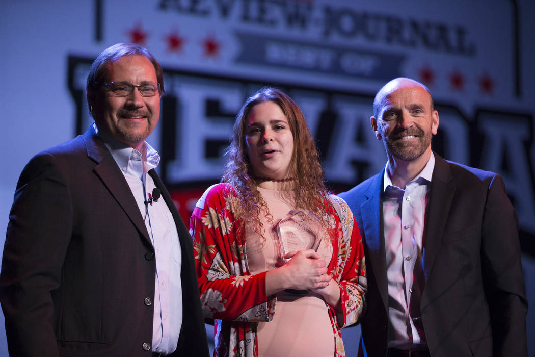 Joelle Beachler, center, is presented with the No Limits Award, by Bill Bradley, left, sport ...