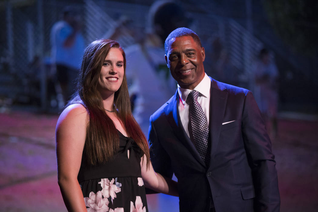 Samantha Pochop, left, is presented with the Female Athlete of the Tear Award by football ha ...