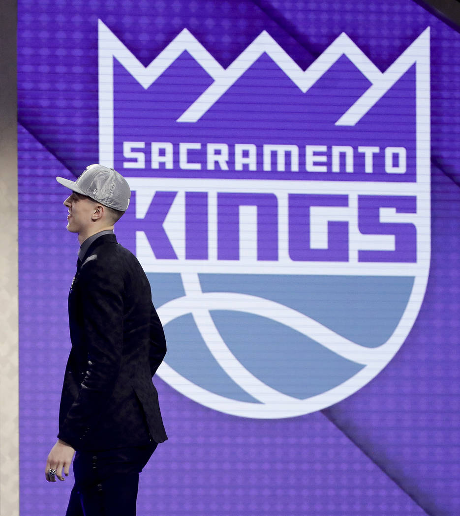 Zach Collins walks up on stage after being selected by the Sacramento Kings as the 10th pick ...