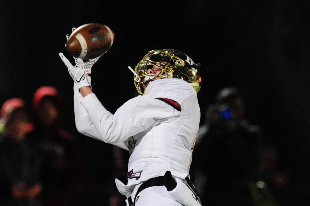 Faith Lutheran wide receiver Elijah Kothe catches a first down pass against Bishop Gorman in ...