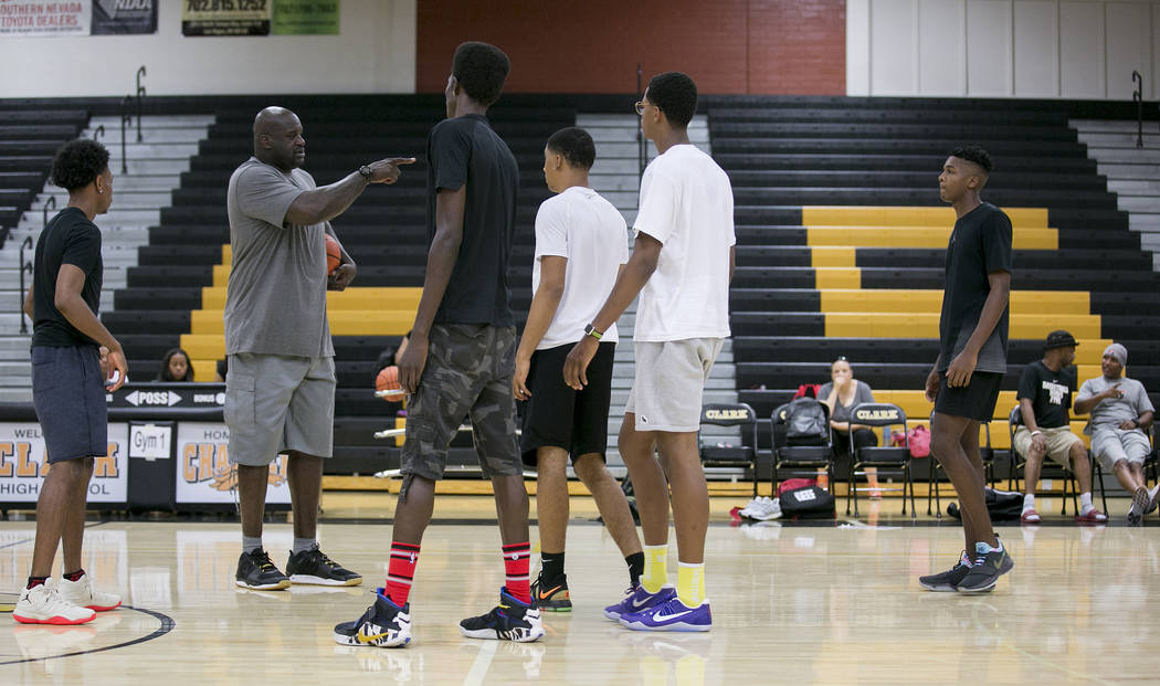 Shaquille O'Neal, left, leads a Cal Supreme practice at Ed W. Clark High School in Las ...