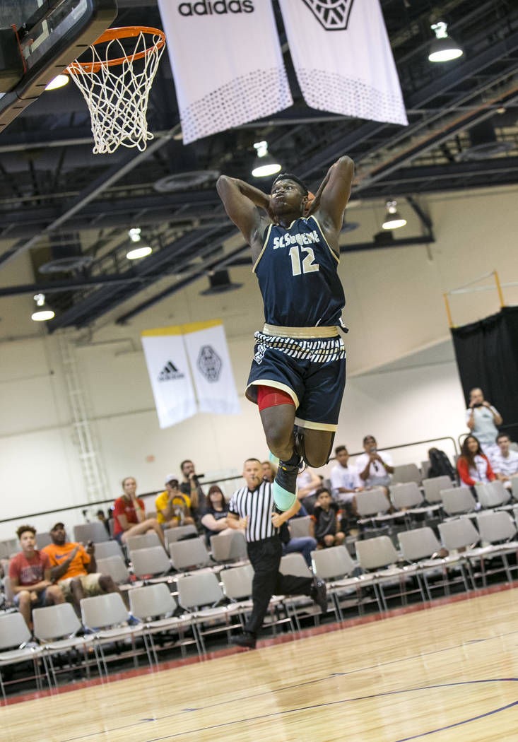 SC Supreme forward Zion Williamson (12) breaks away for a dunk against Play Hard Play Smart ...