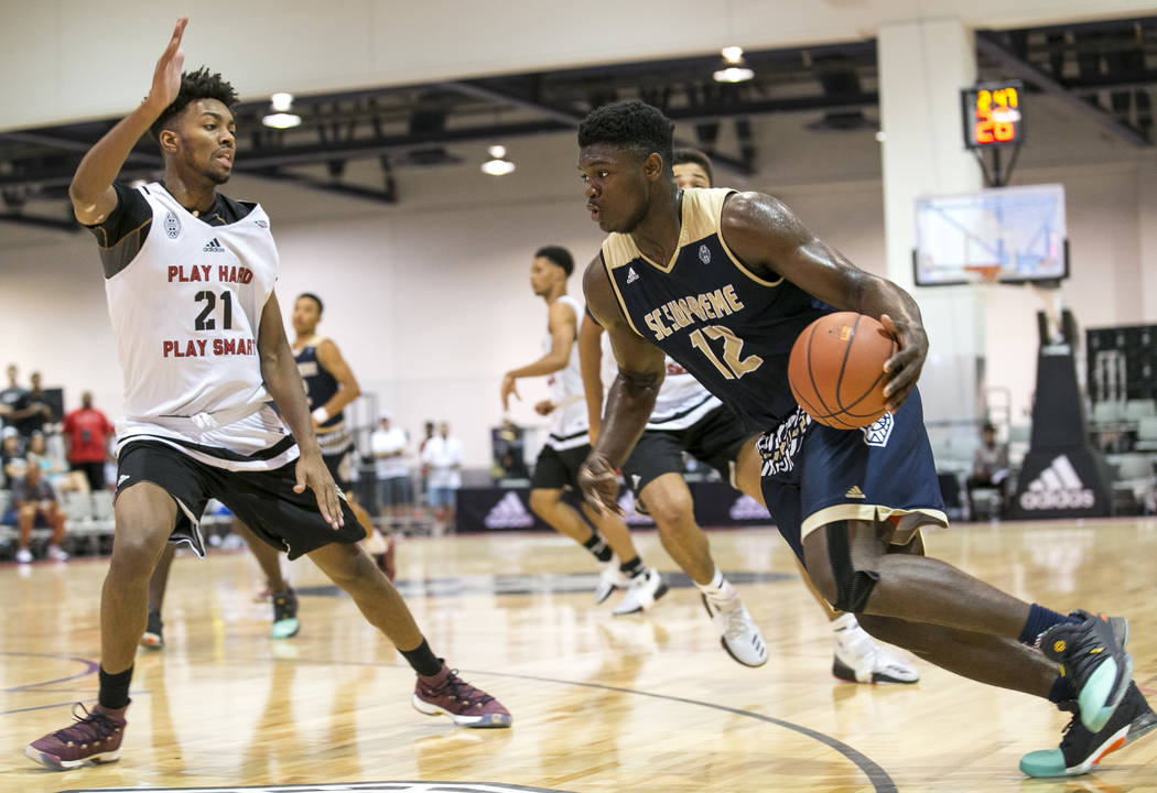 SC Supreme forward Zion Williamson (12) drives the ball under pressure from Play Hard Play S ...