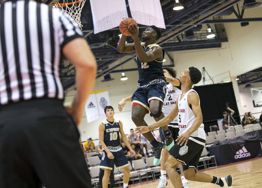 SC Supreme forward Zion Williamson (12) goes up for a shot over Play Hard Play Smart's ...