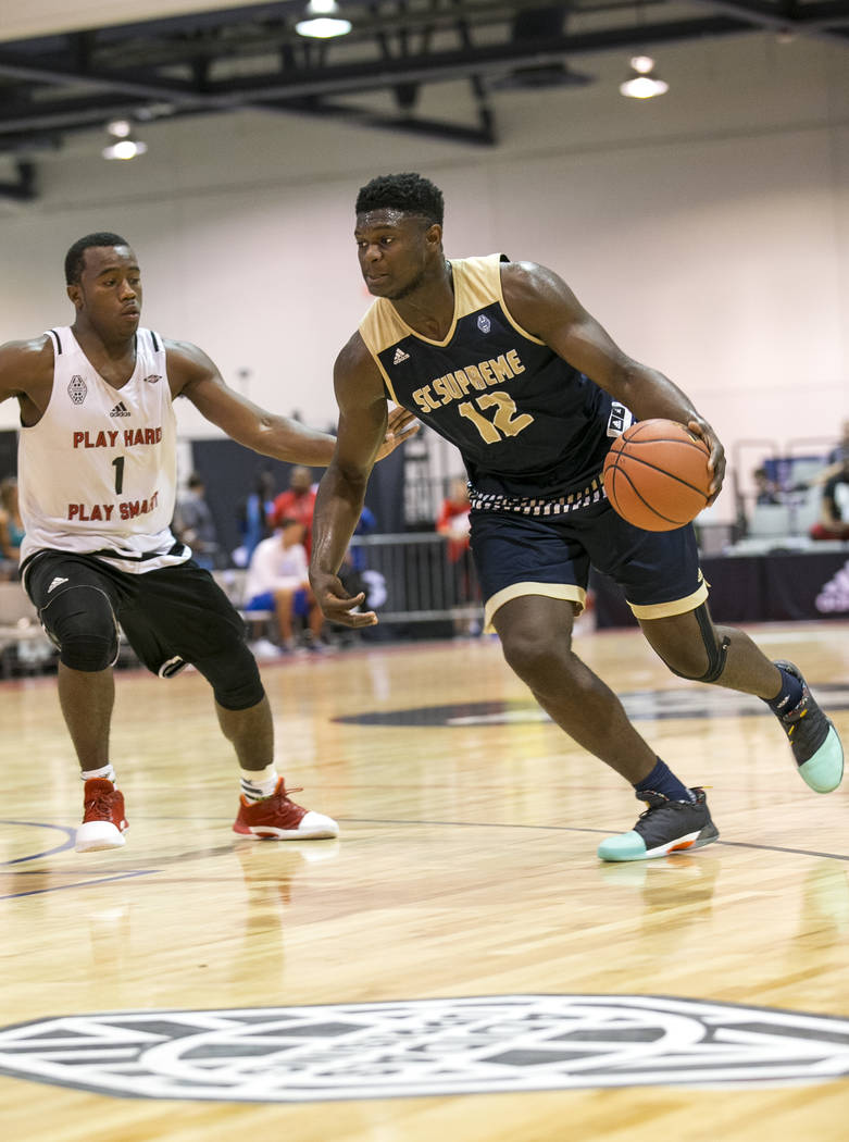 SC Supreme forward Zion Williamson (12) drives to the basket while defended by Play Hard Pla ...