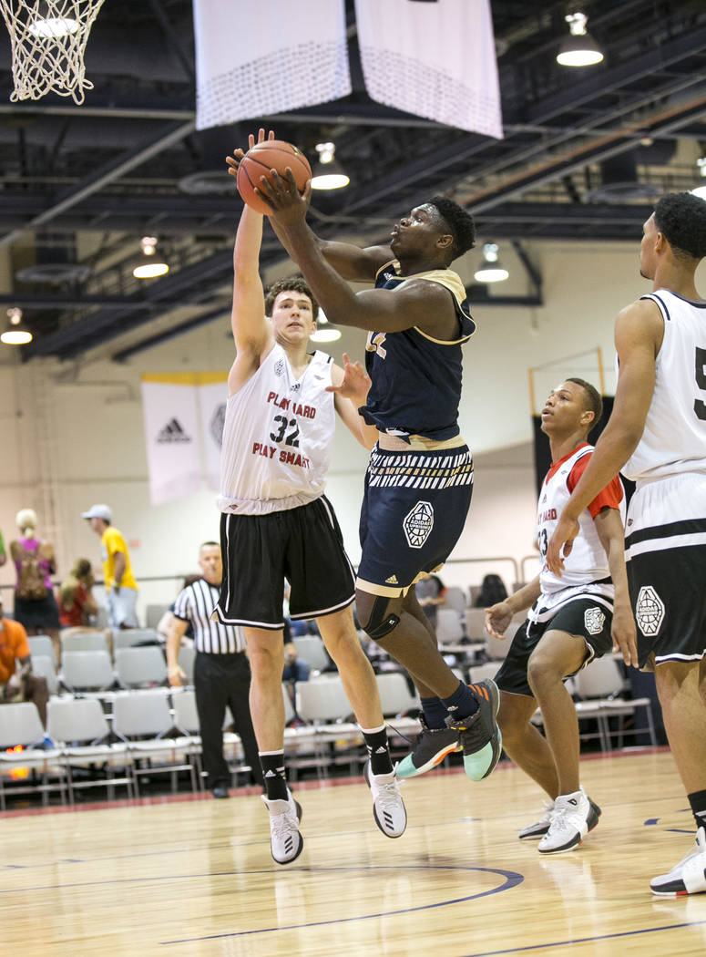 SC Supreme forward Zion Williamson (12) takes a shot under pressure from Play Hard Play Smar ...