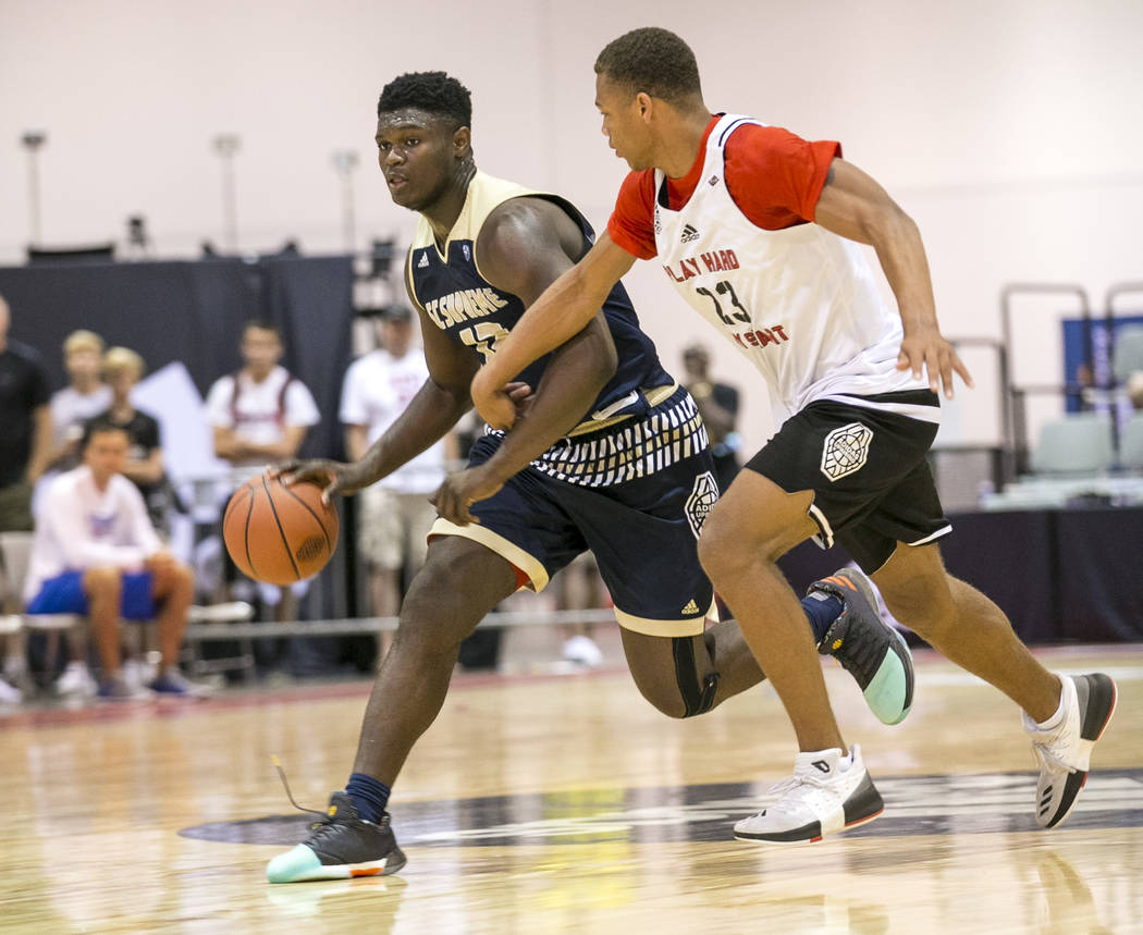 SC Supreme forward Zion Williamson (12) drives the ball by Play Hard Play Smart's Chri ...
