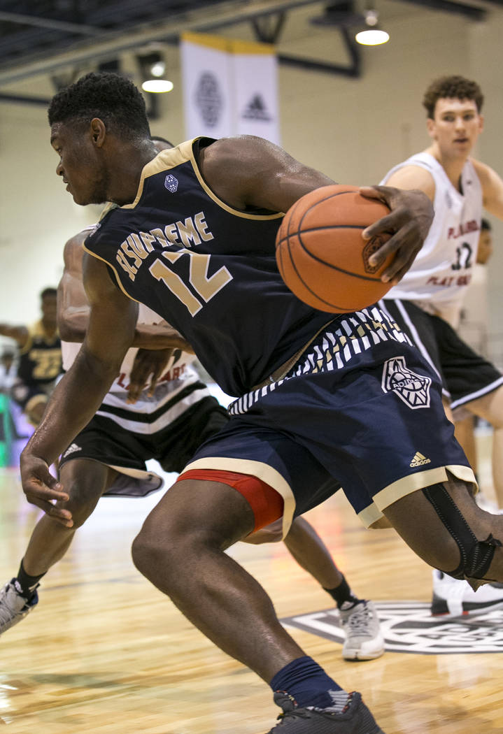 SC Supreme forward Zion Williamson (12) drives the ball under as he is pressured by Play Har ...
