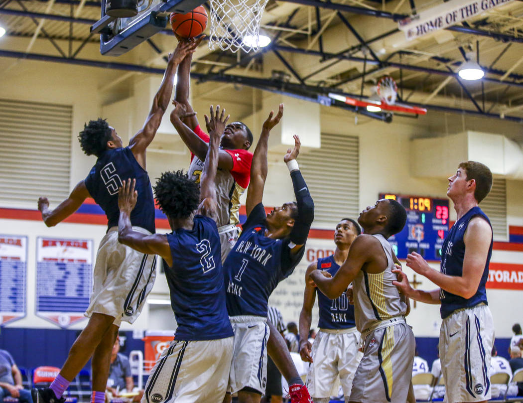 Team Thad's Javian Fleming goes up for a shot against a myriad of New York defenders d ...