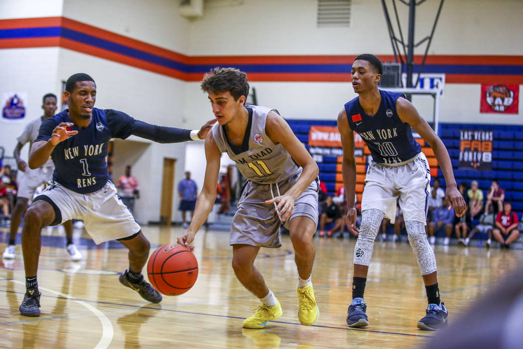 Team Thad's Roman Rubio (11) drives toward the net against New York defenders Luther ...