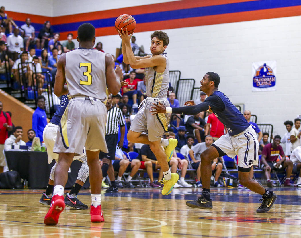 Team Thad's Roman Rubio, center, looks for a pass while playing against New York durin ...