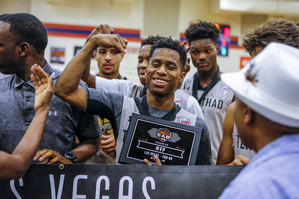Team Thad's Tyler Harris, center, celebrates after being crowned MVP during the Las Ve ...