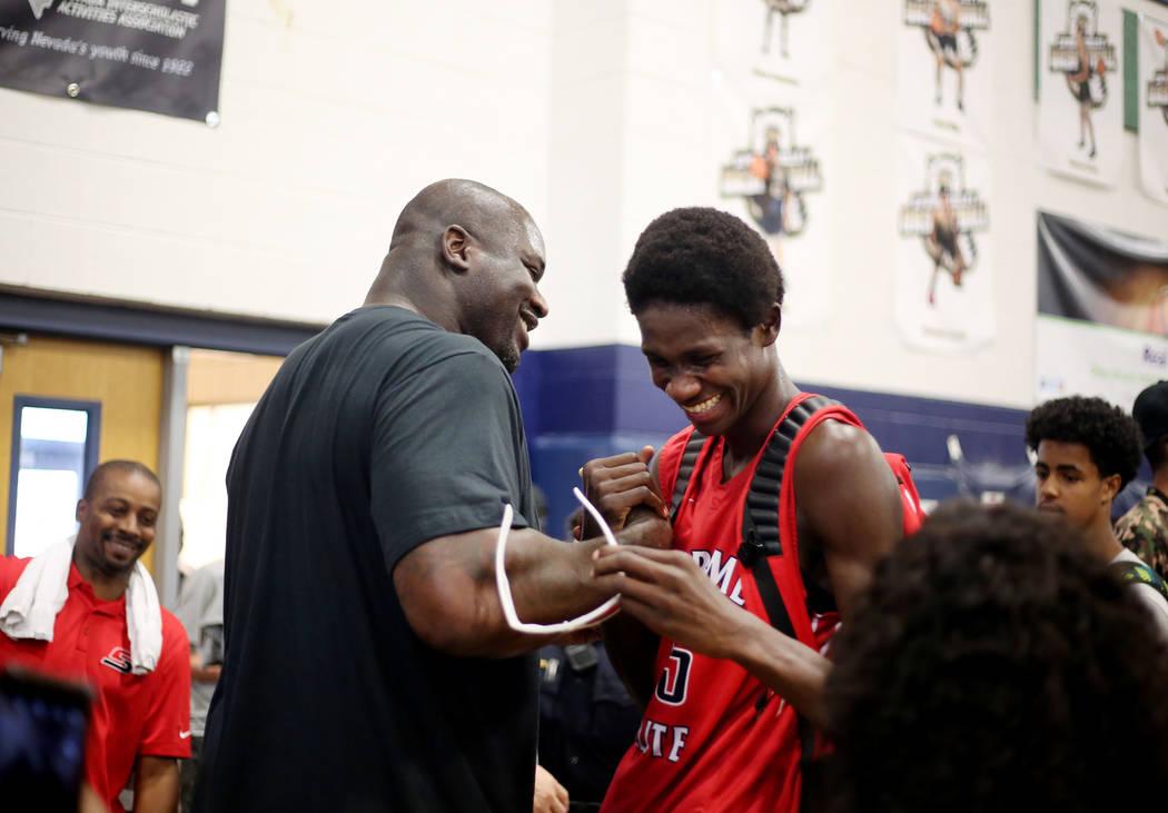 California Supreme assistant coach Shaquille O'Neal congratulates Fred Odhiambo, 15, a ...