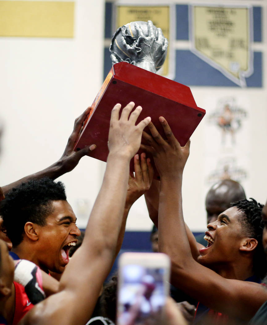California Supreme Elite players hold their Platinum Elite Championship game trophy after wi ...