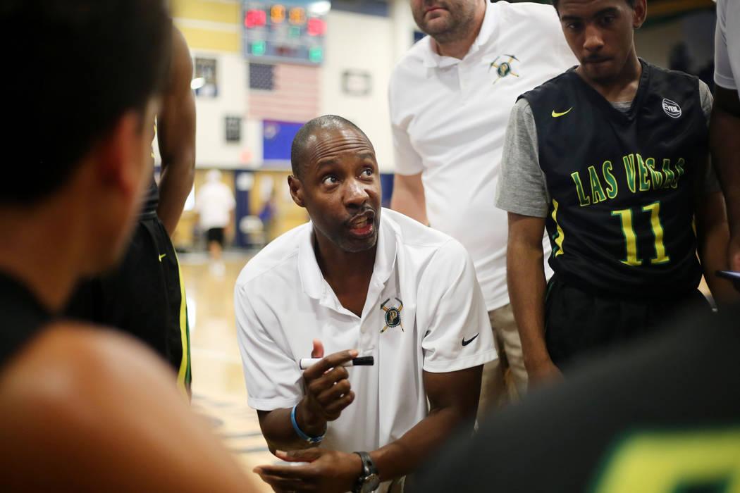 Las Vegas Prospects head coach Derek Thomas speaks with his team during the Platinum Elite C ...