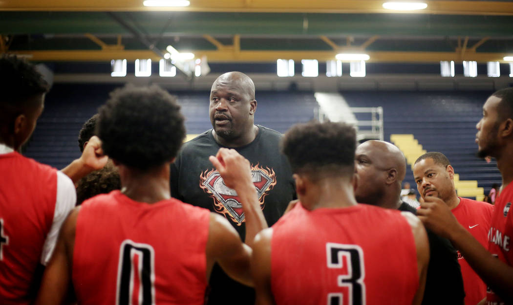 California Supreme Elite assistant coach Shaquille O'Neal speaks with his team on a ti ...