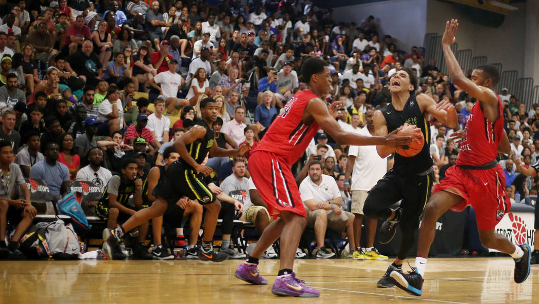 Las Vegas Prospects' Marvin Coleman II, 2, center, handles the ball against California ...