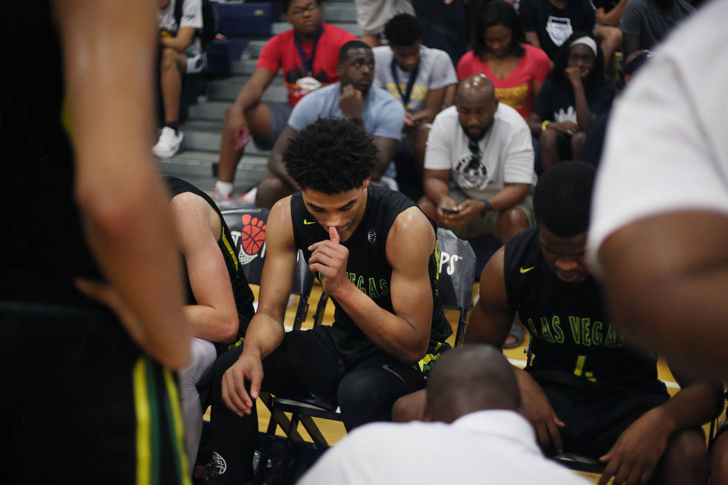 Las Vegas Prospects' Marvin Coleman II, center, listens in a huddle during the Platinu ...