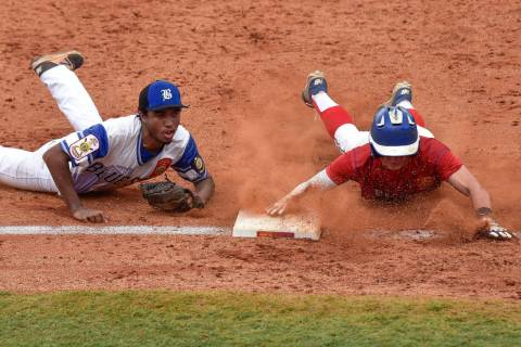 Omaha, Neb., shortstop Zach Luckey slides safely into third in game 2 of The American Legion ...