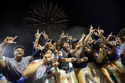 Members of the Henderson, Nev., celebrate following their win in a baseball game against Oma ...