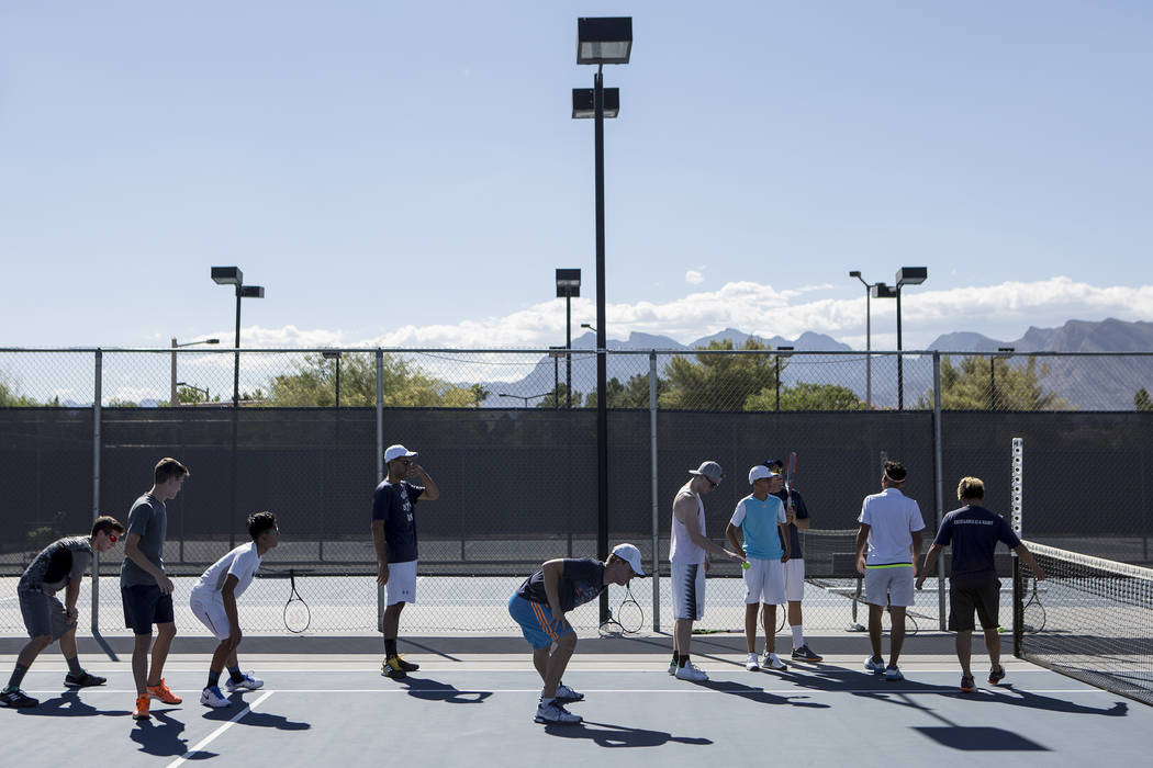 Meadows School tennis players warm upʤuring practice at the Meadows School on Thursday ...