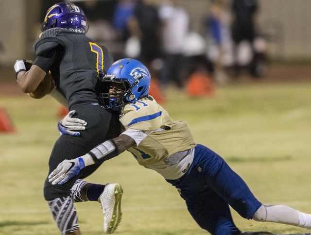 Sierra Vista defender Damaen Bentley (11) tackles Durango's T.K. Fotu on Friday, Oct. ...