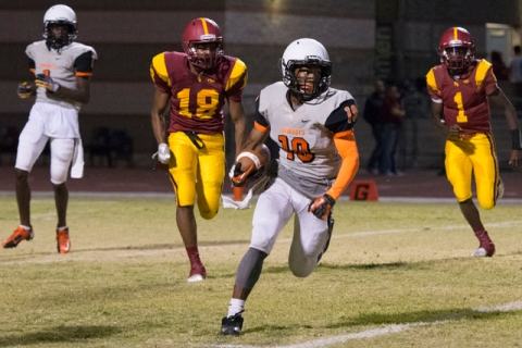 Chaparral's Tyray Collins (19) runs with the ball during a football game at Del Sol in ...
