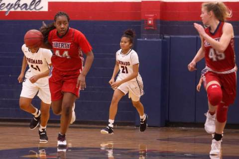 Liberty junior Dre'una Edwards (#44) drives down the court during a basketball game on ...