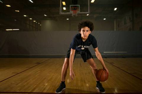 Vegas Elite point guard Richard Isaacs, 14, on the court before a workout session at the Bil ...