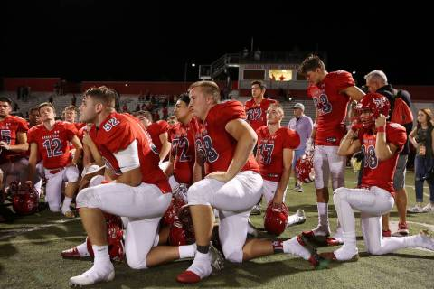 Arbor View take a knee after their 27-24 win over Faith Lutheran at Arbor View High School o ...