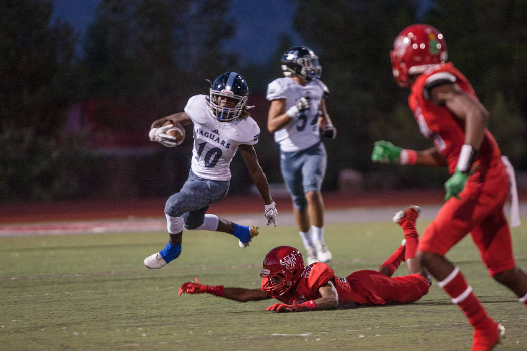 Desert Pines Jaguar wide receiver Devin McGee runs towards the sideline at Arbor View High S ...