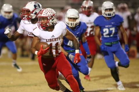 Liberty player Jake Dedeaux (11) runs the ball during the first half a game against Green Va ...