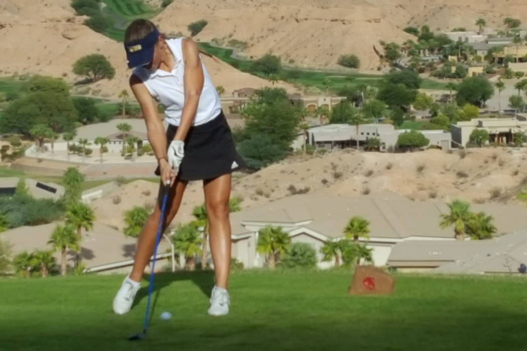 Lani Potter of Boulder City hits her drive on the 16th hole during the Class 3A Southern Reg ...