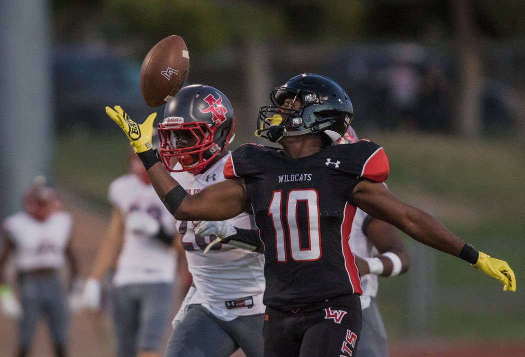 Las Vegas High School Wildcats running back Elijah Hicks prepares for the catch as Arbor Vie ...
